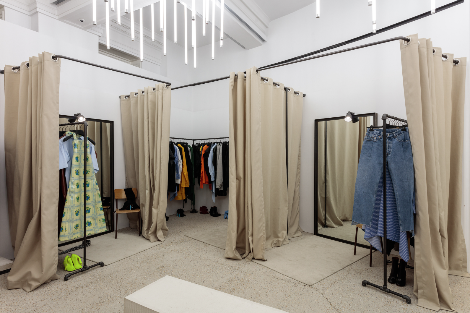 In clothes shop changing room with curtain open - 5 10