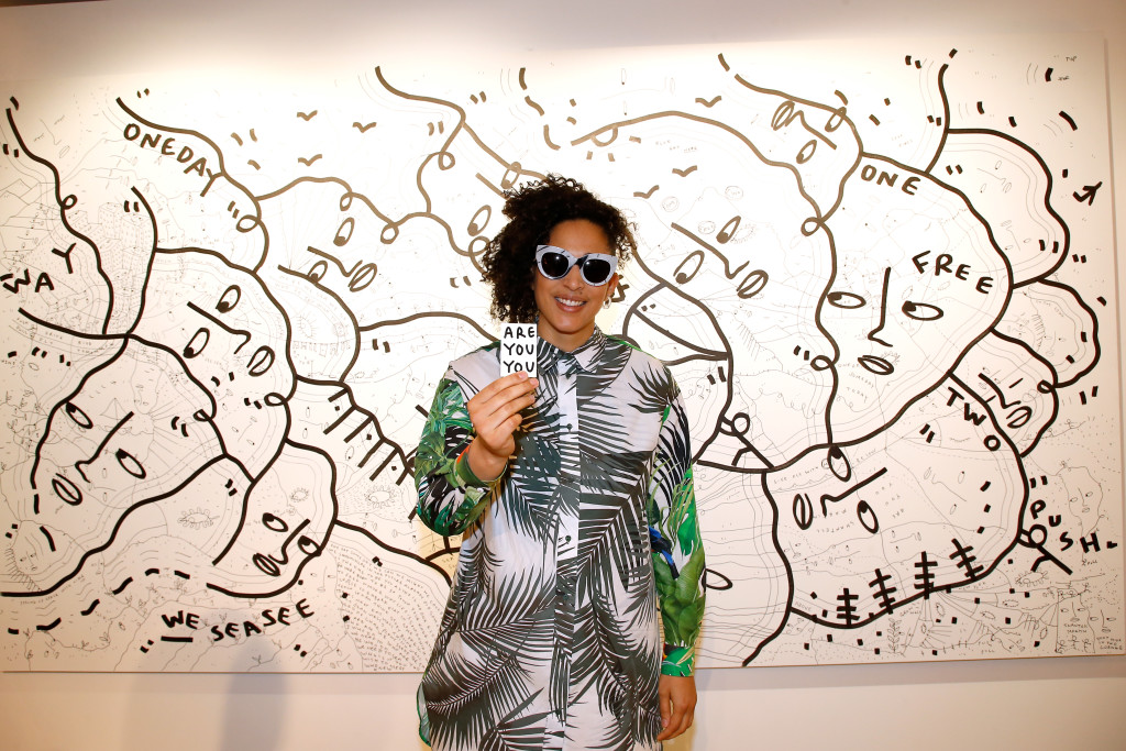 PARIS, FRANCE - MARCH 02:  Artist Shantell Martin poses in front of her work during the Max Mara 'Prism in Motion' Eventas, with the presentation of the new collection Capsule of sunglasses Max Mara, realized in collaboration with the American artist Shantell Martin. As part of Paris Fashion Week Womenswear Fall/Winter 2017/2018 at  on March 2, 2017 in Paris, France.  (Photo by Bertrand Rindoff Petroff/Getty Images for Max Mara) *** Local Caption *** Shantell Martin